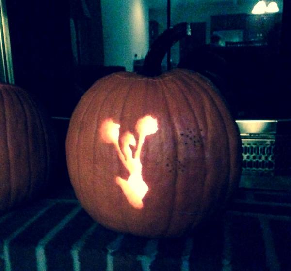 halloween pumpkin of cheerleader with pom poms