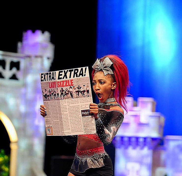 rca lady sizzle themed cheerleading routine with newspaper prop