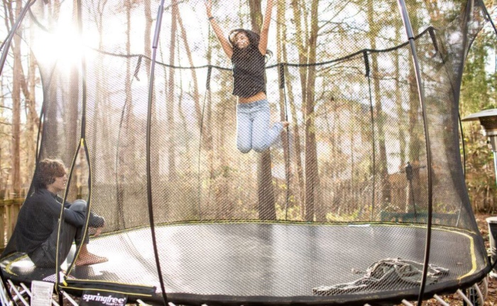 jumping on trampoline at home