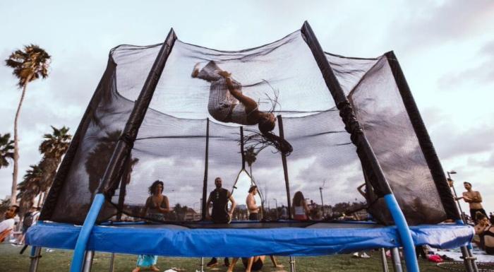 backyard trampoline flip cheerleaders