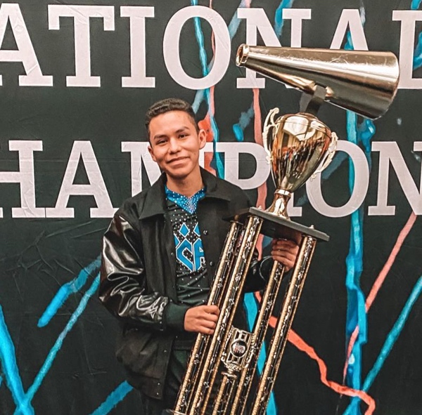 Andy Simon from cheer athletics sabres and Andy Simon cheerleading routines YouTube channel